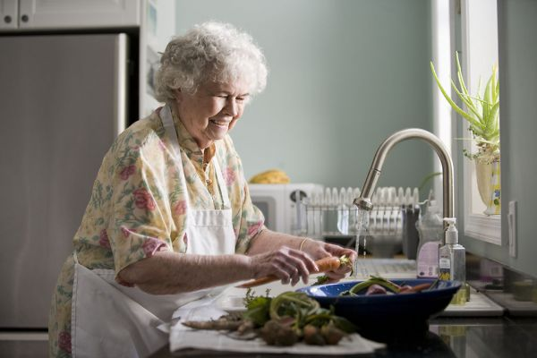 senior-woman-washing-produce