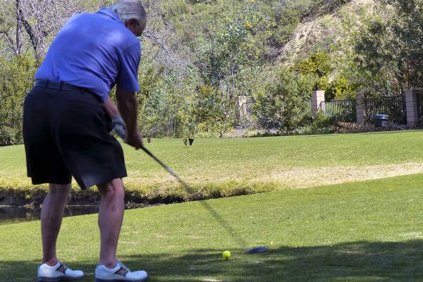 senior-man-playing-golf