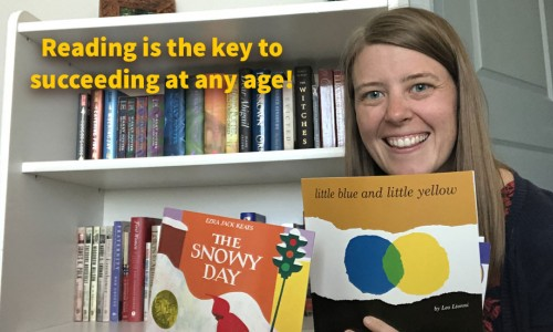 Photo: Abby Rolland, TPF Fellow 2020/21 in front of her book shelf with two books from THIS BOOK IS COOL!