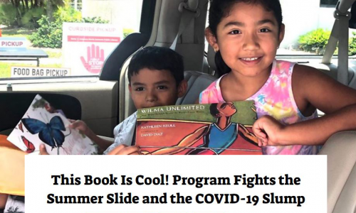 Photo: Two children sitting inside a car showing off thier new books.