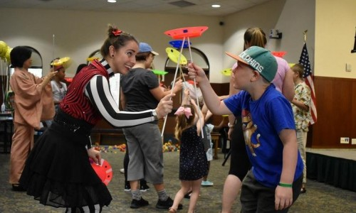 Photo: Andres Rooster 8 plays with a clown from the Circus Arts Conservatory