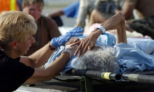 An elderly patient is treated by medics. (U.S. Air Force photo by Master Sgt. Jack Braden)