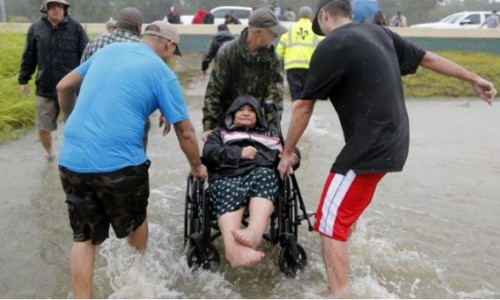 An elderly woman in a wheelchair is rescued from the flood waters of tropical storm Harvey in east Houston, Texas. Credit: Jonathan Bachman/Reuters