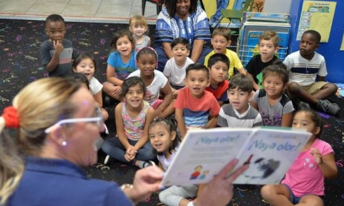 Carina Piovera, owner of My First Step Daycare in Bradenton, reads to children at the center