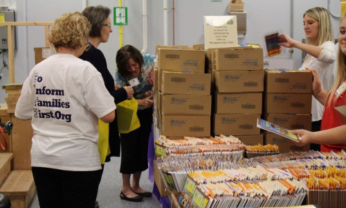 Volunteers organizing materials for the Kindergarten Readiness Bags