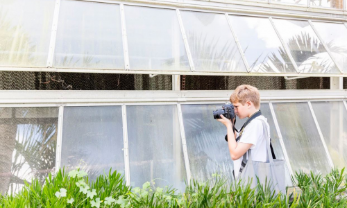 Student from Southside Elementary photographing plant life at Selby Gardens