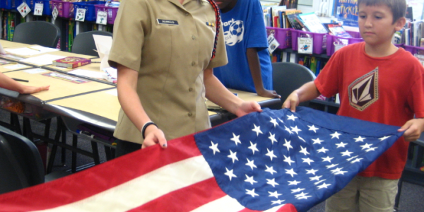 Students complete flag education course with hands-on etiquette lesson