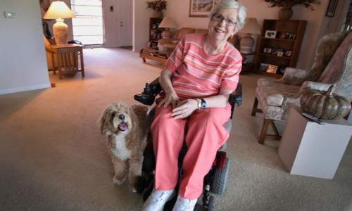 Photo: Sherrill Derrenberger sits with her dog, Max, at her home. She is participating in the Friendship Center's Home Share Program, offering to share her space with someone looking for an affordable place to live