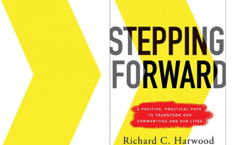 Photo: Stepping Forward book cover in front of two yellow arrows pointing toward the right