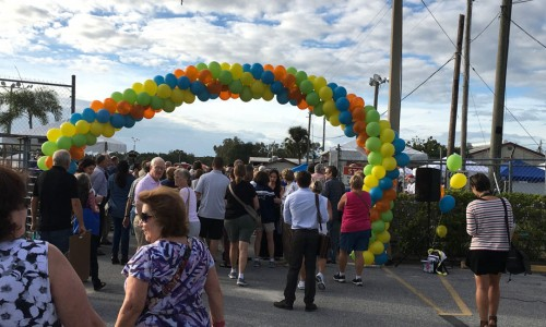 The community entering the Age-Friendly Festival after ribbon cutting ceremony.