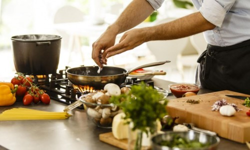 Photo: an image of someone cooking healthy food