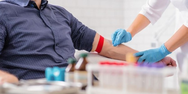 Photo: Older adult about to get blood drawn