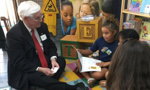 Photo: Superintendent of DeSoto County Schools, Adrian Cline, shares his love of reading with children at the laundromat