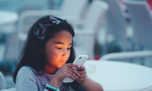 Photo: child watching something on a smart phone
