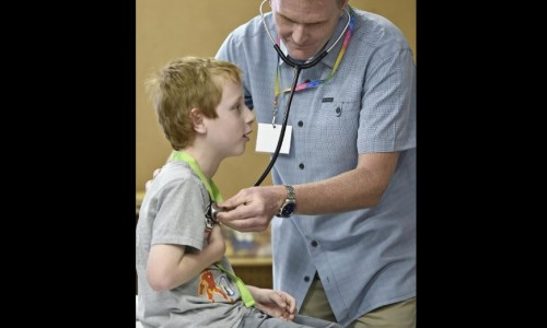 Photo: Little boy getting a check-up